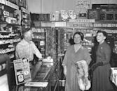 <p>The Queen Mother did not falter in her royal duties after her husband's death. In 1954, she visited the Eisenhower administration on a trip to the United States. Here, she and First Lady Mamie Eisenhower shop at a local store. </p>