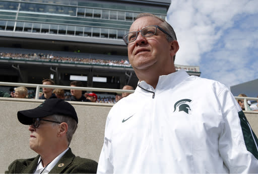 Mark Hollis, right, resigned as Michigan State athletic director just days after MSU president Lou Anna Simon, left, did the same. (AP)
