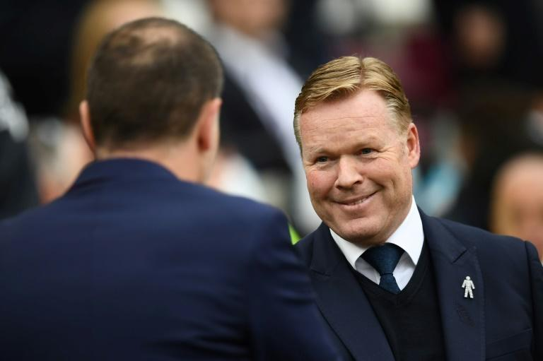 West Ham United's manager Slaven Bilic (L) shakes hands with Everton's counterpart Ronald Koeman ahead of their English Premier League match, at The London Stadium, on April 22, 2017