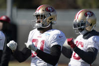 San Francisco 49ers running back Raheem Mostert (31) and San Francisco 49ers running back Tevin Coleman, right, stretches during practice at the team's NFL football training facility in Santa Clara, Calif., Friday, Jan. 24, 2020. The 49ers will face the Kansas City Chiefs in Super Bowl 54. (AP Photo/Tony Avelar)