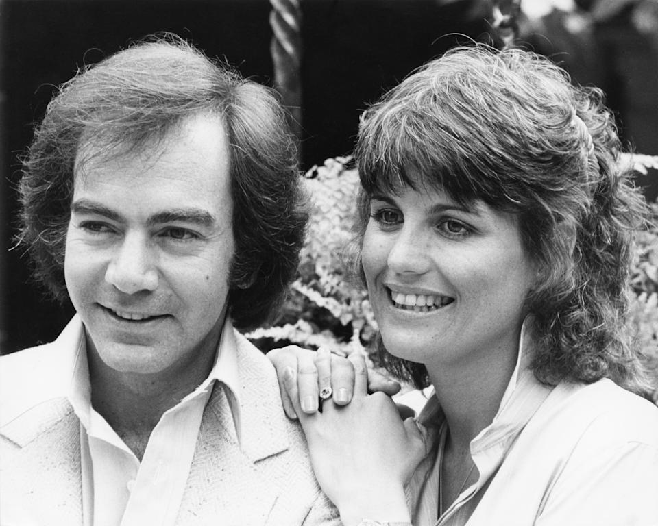 American singer-songwriter Neil Diamond with actress and singer Lucie Arnaz, his co-star in the film 'The Jazz Singer', circa 1980. (Photo by Richard Blanshard/Getty Images)