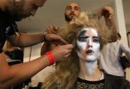 A model has her hair styled backstage before the Vivienne Westwood Red Label Spring/Summer 2014 collection presentation during London Fashion Week September 15, 2013. REUTERS/Suzanne Plunkett
