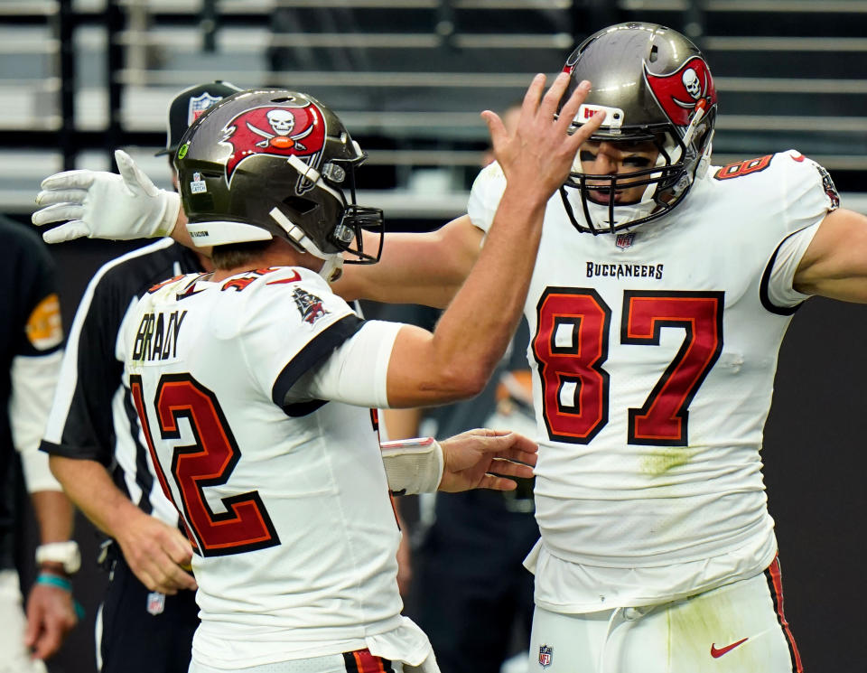 FILE - In this Oct. 25, 2020, file photo, Tampa Bay Buccaneers tight end Rob Gronkowski (87) celebrates with quarterback Tom Brady (12), left, after scoring a touchdown against the Las Vegas Raiders during the first half of an NFL football game in Las Vegas. Gronkowski is one of 218 players to appear in a Super Bowl as Brady's teammate, a number that will grow by more than 40 this week when Brady makes his record 10th trip to to the title game. (AP Photo/Jeff Bottari, File)