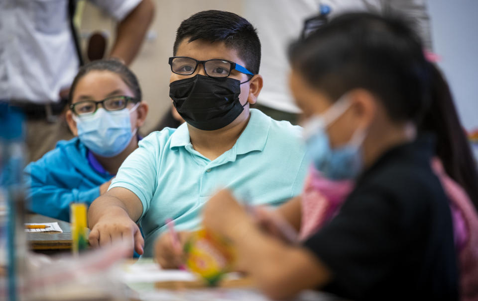 Kids wearing masks to school is a touchy subject. (Allen J. Schaben / Los Angeles Times via Getty Images)