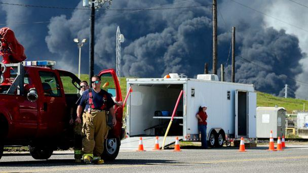PHOTO: Firefighters arrive at the site where the Intercontinental Terminals Company petrochemical fire reignited, Friday, March 22, 2019, in Deer Park, Texas. (AP)
