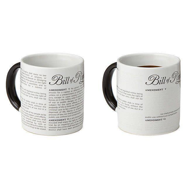 """It's clever: When you pour your preferred drink into this mug, some rights stay, while others fade away. Just a little wake-up call (or morning pick-me-up?) that says why voting's important. <br><br><a href=""""https://fave.co/30RauZl"""" rel=""""nofollow noopener"""" target=""""_blank"""" data-ylk=""""slk:Find it for $14 at Uncommon Goods"""" class=""""link rapid-noclick-resp"""">Find it for $14 at Uncommon Goods</a>."""