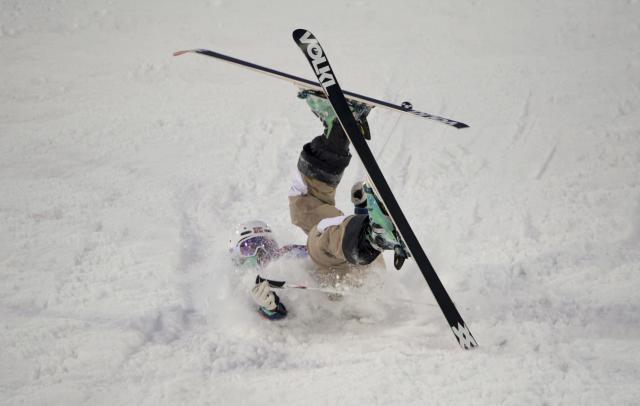 Norway's Hedvig Wessel crashes during a qualification heat in women's moguls at the Sochi Winter Olympics in Krasnaya Polyana, Russia, on Saturday Feb. 8, 2014. (AP Photo/The Canadian Press, Adrian Wyld)