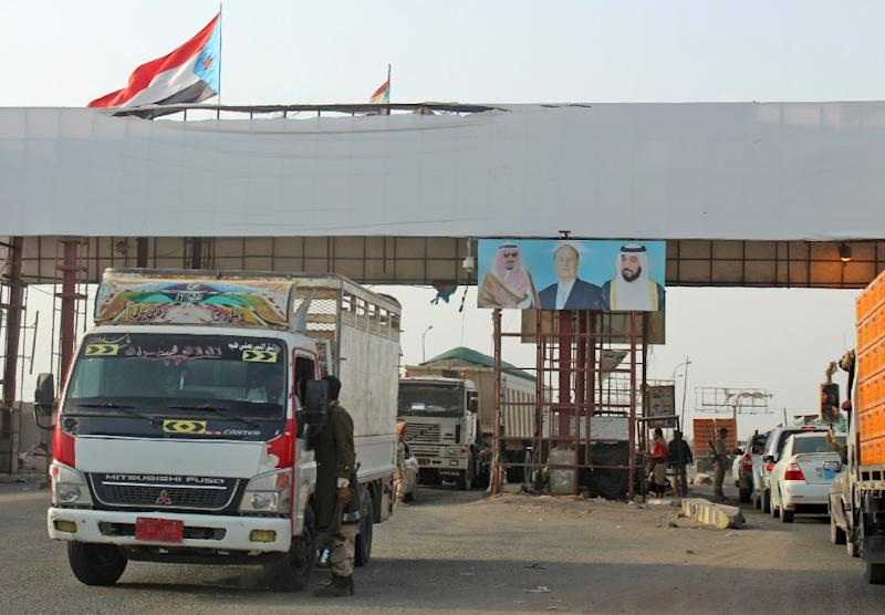 The flag of southern Yemeni separatists with a sky blue chevron in the corner flies over a checkpoint in the north of Aden (AFP Photo/SALEH AL-OBEIDI)