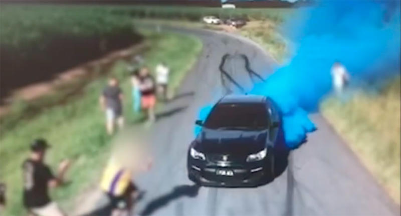 A Holden Commodore sent out plumes of blue smoke while doing a burnout in a gender reveal attempt.