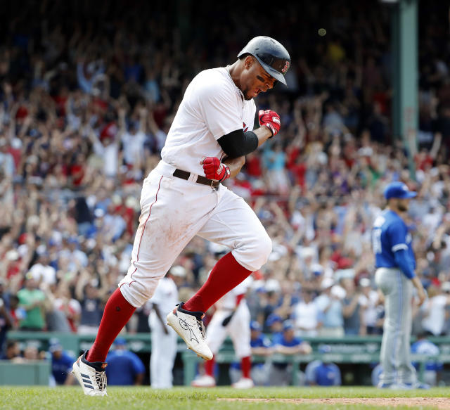 Boston Red Sox' Xander Bogaerts celebrates while rounding the bases after hitting a grand slam in the 10th inning as Toronto Blue Jays pitcher Chris Rowley, right, watches, Saturday, July 14, 2018, in Boston. The Red Sox on 6-2. (AP Photo/Winslow Townson)