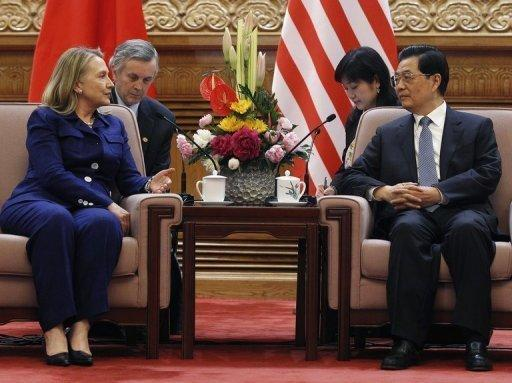 Chinese President Hu Jintao (R) speaks with US Secretary of State Hillary Clinton at the Great Hall of the People in Beijing on May 4. China's foreign ministry said on Friday that he would be allowed to apply to study abroad, signalling then-visiting Clinton had secured a deal with the Chinese government