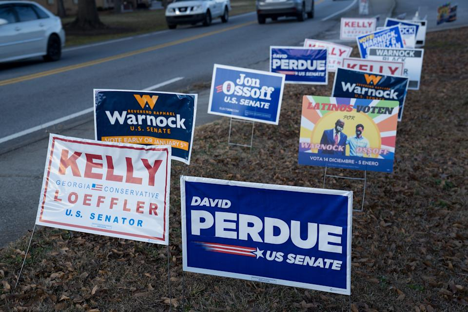 Campaign signs on Jan. 5, 2021, in Atlanta.