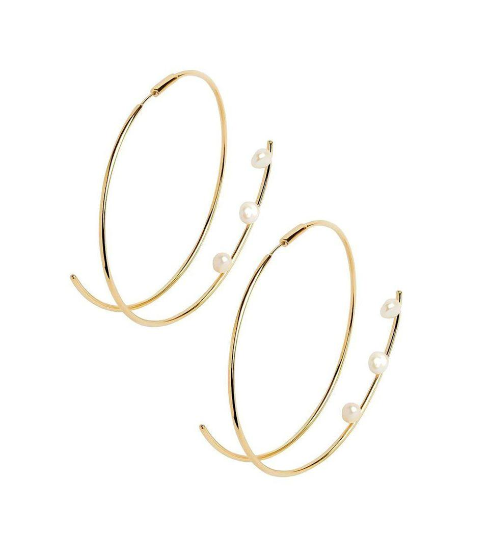 """<p><strong>Maria Black</strong></p><p>ShopBAZAAR.com</p><p><strong>$650.00</strong></p><p><a href=""""https://go.redirectingat.com?id=74968X1596630&url=https%3A%2F%2Fshop.harpersbazaar.com%2Fdesigners%2Fmaria-black%2Fshowtime-earrings-49357.html&sref=https%3A%2F%2Fwww.harpersbazaar.com%2Ffashion%2Ftrends%2Fg34644326%2Fholiday-jewelry%2F"""" rel=""""nofollow noopener"""" target=""""_blank"""" data-ylk=""""slk:Shop Now"""" class=""""link rapid-noclick-resp"""">Shop Now</a></p><p>This unique shape features tiny freshwater pearls in a sculptural piece that is both dainty and powerful. It's a pair of earrings that will earn its keep—you'll be wearing them well after the holidays.</p>"""
