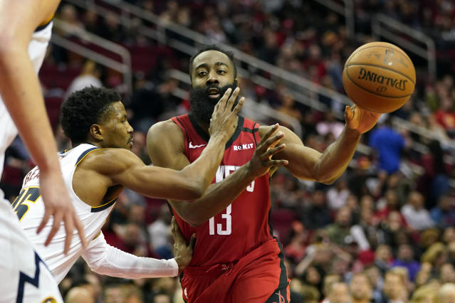 Houston Rockets' James Harden (13) passes the ball as Denver Nuggets' Malik Beasley (25) defends during the second half of an NBA basketball game Wednesday, Jan. 22, 2020, in Houston. The Rockets won 121-105. (AP Photo/David J. Phillip)