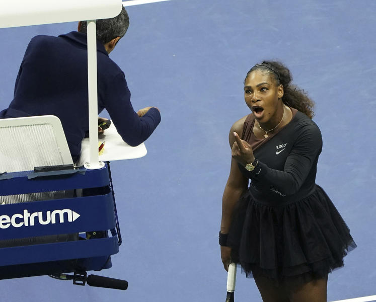 "FILE - In this Saturday, Sept. 8, 2018, file photo, Serena Williams argues with the chair umpire during a match against Naomi Osaka, of Japan, during the women's finals of the U.S. Open tennis tournament at the USTA Billie Jean King National Tennis Center, in New York. Some black women say Serena Williams' experience at the U.S. Open final resonates with them. They say they are often forced to watch their tone and words in the workplace in ways that men and other women are not. Otherwise, they say, they risk being branded an ""Angry Black Woman."" (Photo by Greg Allen/Invision/AP, File)"