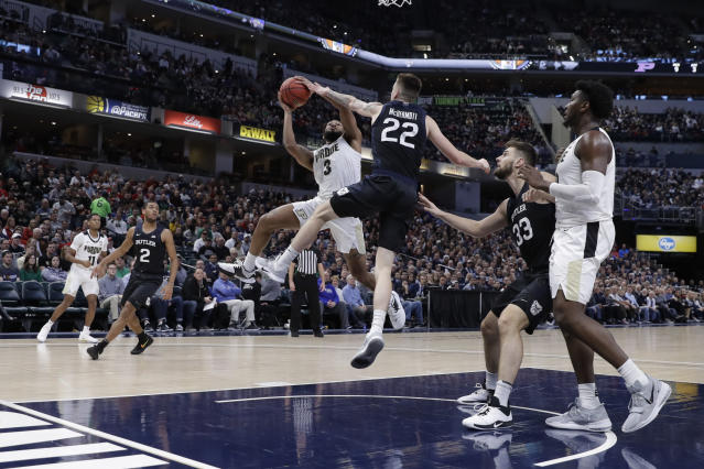 Purdue's Jahaad Proctor (3) shoots against Butler's Sean McDermott (22) during the first half of an NCAA college basketball game, Saturday, Dec. 21, 2019 in Indianapolis. (AP Photo/Darron Cummings)