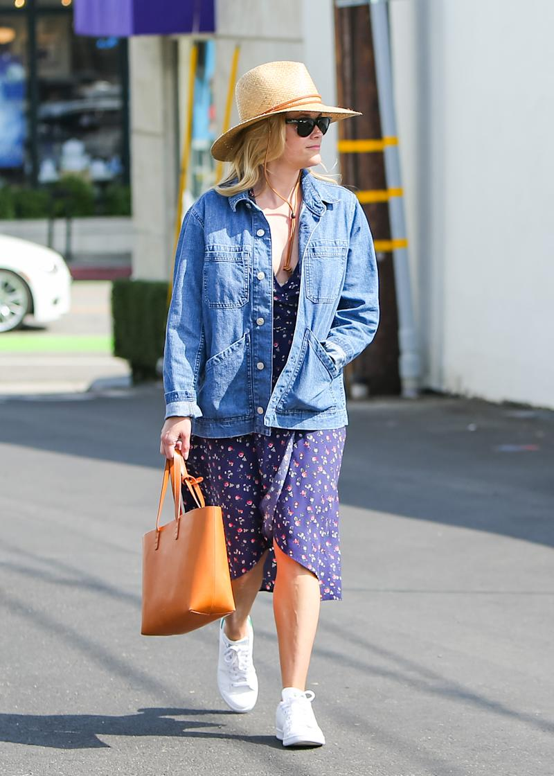 Reese Witherspoon wears her adidas Stan Smith Sneaker while running errands (via Getty Images)
