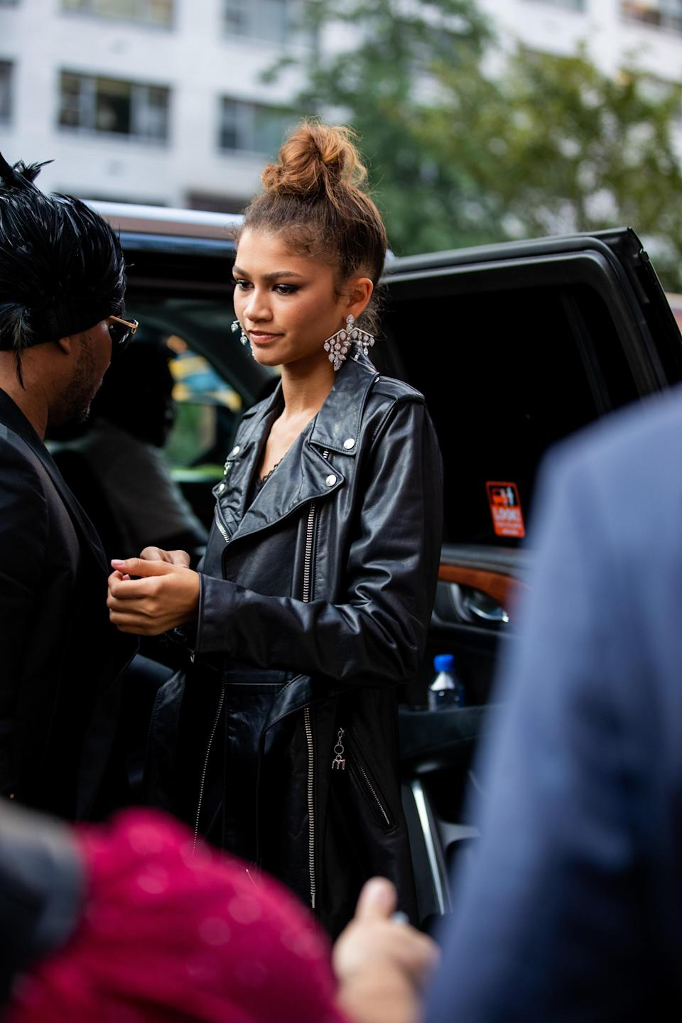 Spotted: Zendaya wearing the wispiest topknot we've ever seen.
