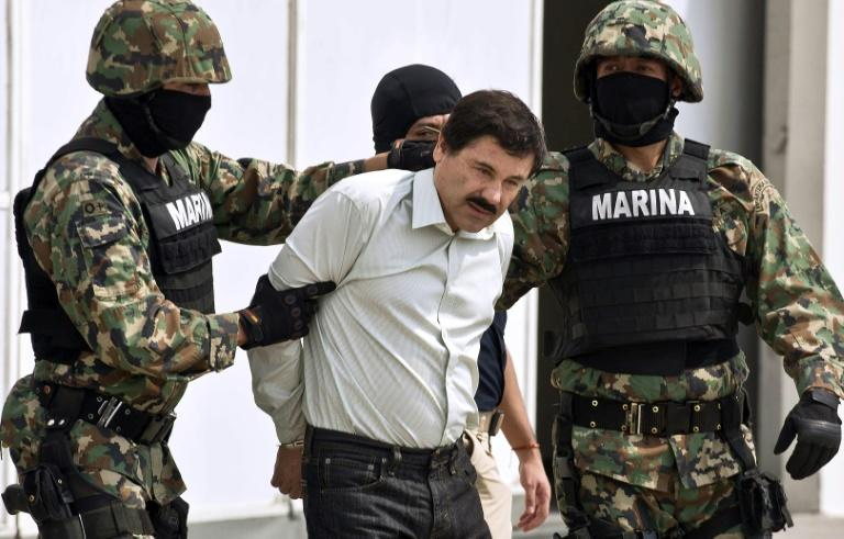 Joaquin 'El Chapo' Guzman is escorted by marines as he is presented to reporters in Mexico City soon after his arrest in February 2014