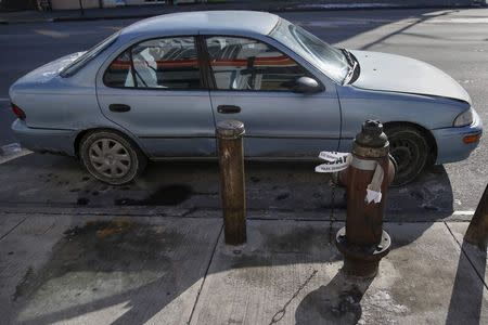 An automobile sits illegally parked without a parking ticket issued by the NYPD in the Queens borough of New York January 7, 2015. REUTERS/Shannon Stapleton