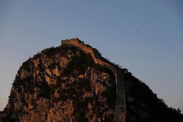 <p>An airplane flies over the Jiankou section of the Great Wall, located in Huairou District, north of Beijing, China, June 7, 2017. (Photo: Damir Sagolj/Reuters) </p>