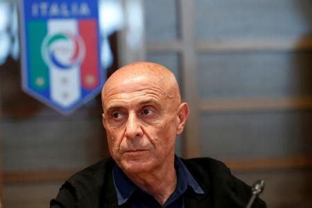 FILE PHOTO: Italian Interior Minister Marco Minniti is seen during a meeting at the FIGC (Italian Football Federation) headquarter in Rome, Italy August 4, 2017. REUTERS/Remo Casilli