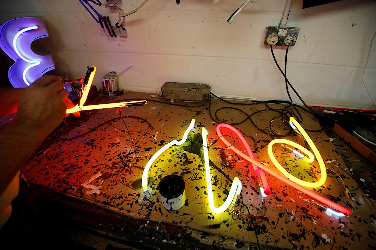 <p>A newly design neon sign artwork is tested for color on a bench in the workshop for God's Own Junkyard in Rainham, east London, Britain, May 17, 2017. (Photo: Russell Boyce/Reuters) </p>