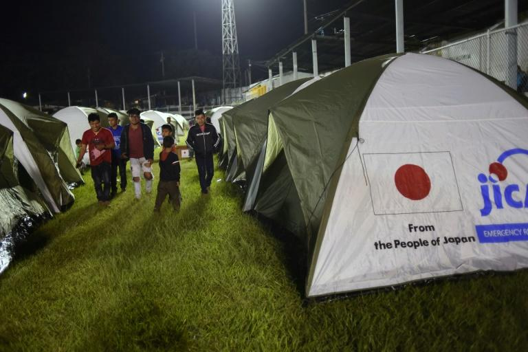 Residents of several communities located near the erupting Fuego volcano were housed in tents in Escuintla on November 19, 2018