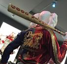 "<p>Her bedazzled jacket reads ""Property of Joker"" and ""Puddin Freaky."" Her bat is inscribed with ""Good Night"" and her twisted lyrics to the childhood lullaby ""Hush, Little Baby.""</p>"