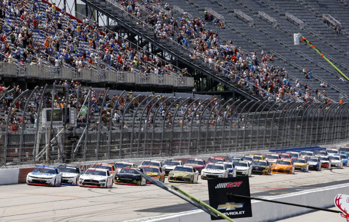 A J Allmendinger, left, leads the field at the start of the NASCAR Xfinity Series auto race at Darlington Raceway, Saturday, May 8, 2021, in Darlington, S.C. (AP Photo/Terry Renna)