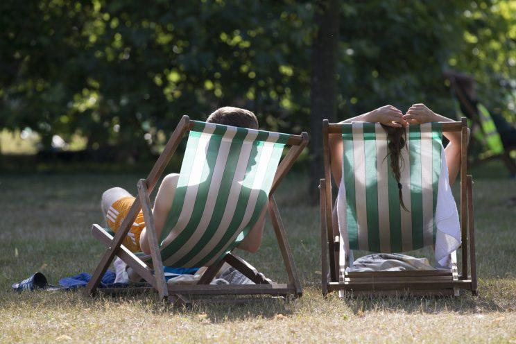 Many workers would gladly swap the office chair for a deckchair... (Oli Scarff/Getty Images)