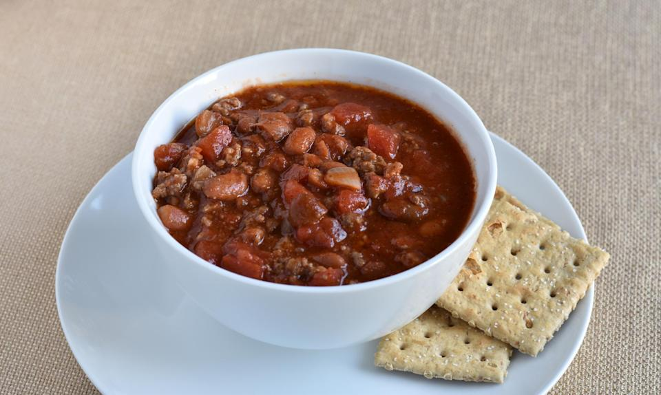 """<p><a href=""""https://www.thedailymeal.com/eat/texas-chili-no-beans?referrer=yahoo&category=beauty_food&include_utm=1&utm_medium=referral&utm_source=yahoo&utm_campaign=feed"""" rel=""""nofollow noopener"""" target=""""_blank"""" data-ylk=""""slk:If you ask a Texan"""" class=""""link rapid-noclick-resp"""">If you ask a Texan</a>, beans have no business being in chili. But in other <a href=""""https://www.thedailymeal.com/eat/regional-american-chili-styles?referrer=yahoo&category=beauty_food&include_utm=1&utm_medium=referral&utm_source=yahoo&utm_campaign=feed"""" rel=""""nofollow noopener"""" target=""""_blank"""" data-ylk=""""slk:regional American styles of chili"""" class=""""link rapid-noclick-resp"""">regional American styles of chili</a>, beans are a must. Another debate entirely is how chili should be served. Cincinnati-style comes on a bed of spaghetti, for example.</p>"""