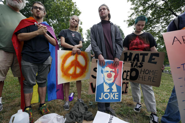 """Counterprotesters wait for the start of a planned """"Free Speech"""" rally on Boston Common, Saturday, Aug. 19, 2017, in Boston. Police Commissioner William Evans said Friday that 500 officers, some in uniform, others undercover, would be deployed to keep the two groups apart. (AP Photo/Michael Dwyer)"""