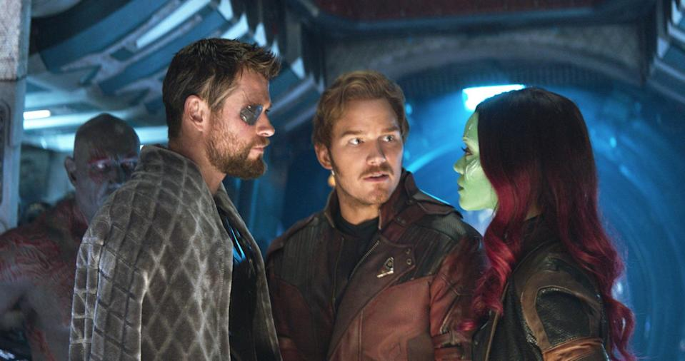 Marvel Studios' AVENGERS: INFINITY WAR..L to R: Thor (Chris Hemsworth), Star-Lord/Peter Quill (Chris Pratt) and Gamora (Zoe Saldana), b/g Drax (Dave Bautista)