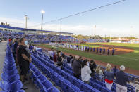 The Los Angeles Angels and Toronto Blue Jays line up for the anthems prior to a baseball game Thursday, April 8, 2021, in Dunedin, Fla. (AP Photo/Mike Carlson)
