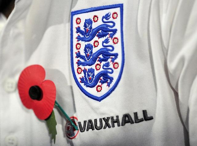 The English and Scottish football associations had been negotiating with the world governing body, which bans political, commercial and religious symbols on team outfits during matches (AFP Photo/Glyn Kirk)