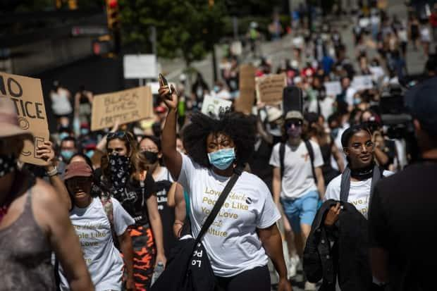 People participate in an Emancipation Day march in Vancouver on Saturday, Aug. 1, 2020, marking the abolition of slavery in parts of the British Empire. In a vote in the House of Commons earlier this year, the federal government officially recognized Emancipation Day. (Darryl Dyck/The Canadian Press - image credit)