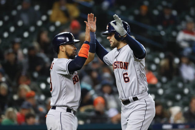 Houston Astros' Jake Marisnick (6) celebrates his two-run home run with teammate Robinson Chirinos in the seventh inning of a baseball game against the Detroit Tigers in Detroit, Monday, May 13, 2019. (AP Photo/Paul Sancya)