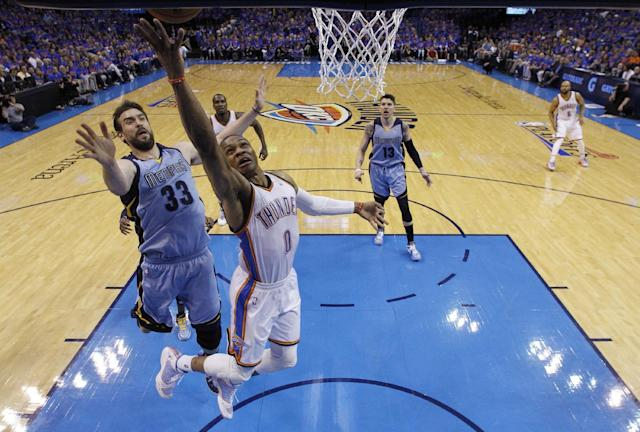 Oklahoma City Thunder guard Russell Westbrook (0) releases a shot in front of Memphis Grizzlies center Marc Gasol (33) in the second quarter of Game 7 of an opening-round NBA basketball playoff series in Oklahoma City, Saturday, May 3, 2014. Oklahoma City won 120-109. (AP Photo/Sue Ogrocki)