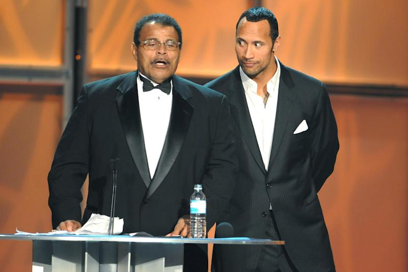Rocky Johnson, left, pictured with his son Dwayne 'The Rock' Johnson: MediaPunch/REX/Shutterstock