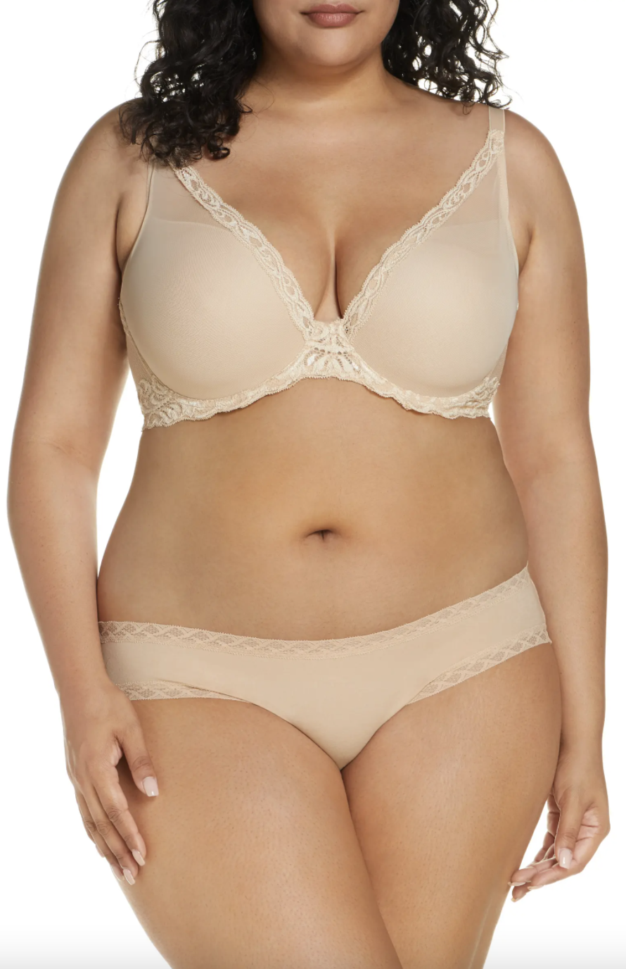 plus size model wearing nude lace bra and nude lace panties