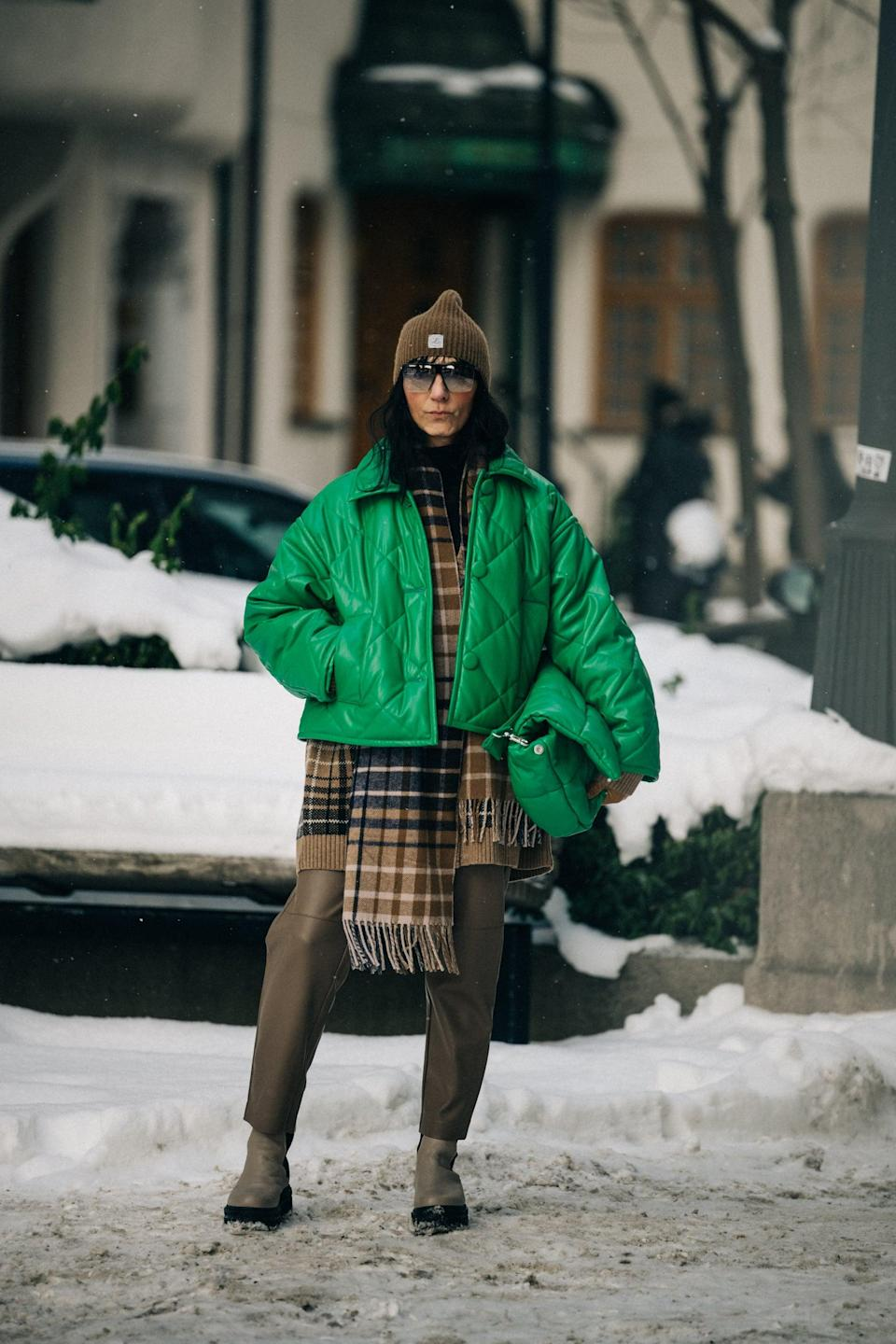 <p>Get creative with your proportions - a cropped electric green bomber looks so cool over a longer-length plaid scarf.</p>