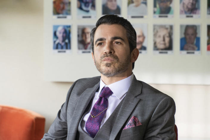 """This image released by Netflix shows Chris Messina in a scene from """"I Care A Lot."""" (Seacia Pavao/Netflix via AP)"""