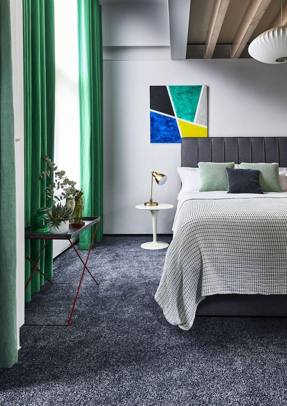 """<p>Grey is a bit of a gift when it comes to colour schemes because it goes with just about anything. A rich, graphite grey tends to make bright colours even more vivid. It is a useful tool to wake up a room by highlighting bold features – like these dramatic green curtains.<br></p><p>Pictured: <a href=""""https://www.carpetright.co.uk/carpets/super-sublime-saxony-carpet/"""" rel=""""nofollow noopener"""" target=""""_blank"""" data-ylk=""""slk:House Beautiful Super Sublime Carpet at Carpetright"""" class=""""link rapid-noclick-resp"""">House Beautiful Super Sublime Carpet at Carpetright</a></p>"""