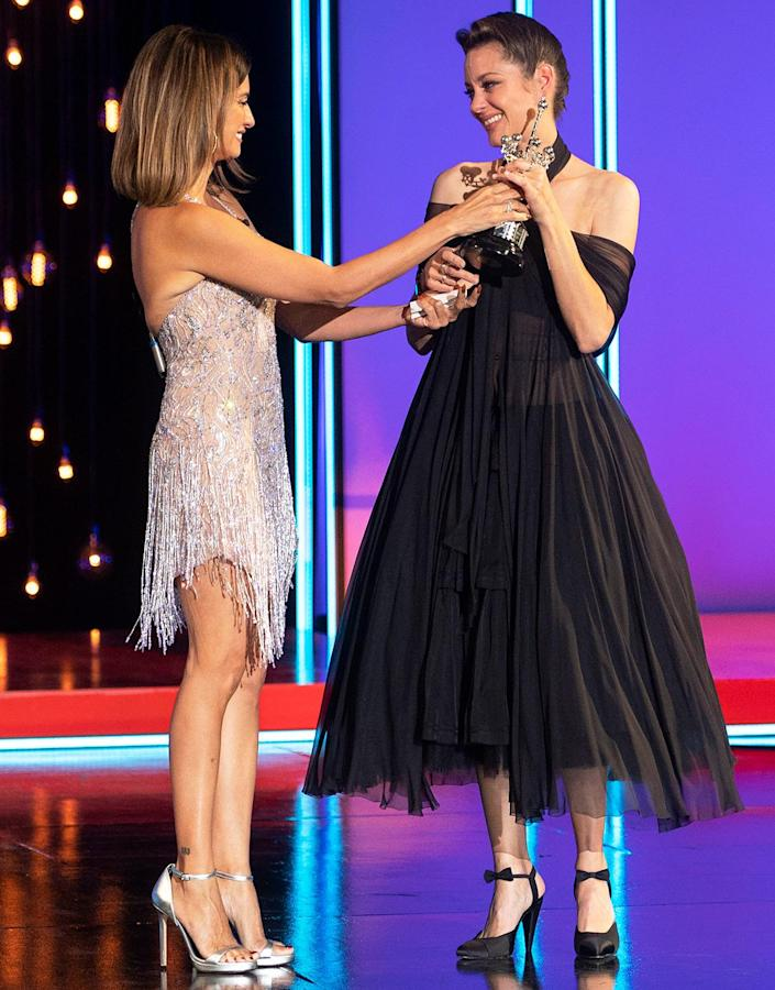 <p>Penélope Cruz presents Marion Cotillard with the Donostia Award during the opening gala of the San Sebastian Film Festival in Spain on Sept. 17.</p>