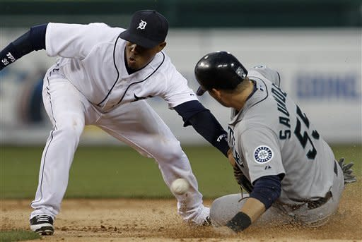 Seattle Mariners' Michael Saunders (55) steals second base as Detroit Tigers second baseman Ramon Santiago (39) can't handle the throw from catcher Alex Avilla in the third inning of a baseball game in Detroit, Wednesday, April 25, 2012. (AP Photo/Paul Sancya)