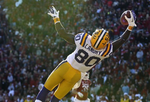 LSU wide receiver Jarvis Landry (80) makes a leaping 22-yard touchdown reception during the second quarter of an NCAA college football game against Arkansas in Fayetteville, Ark., Friday, Nov. 23, 2012. (AP Photo/David Quinn)