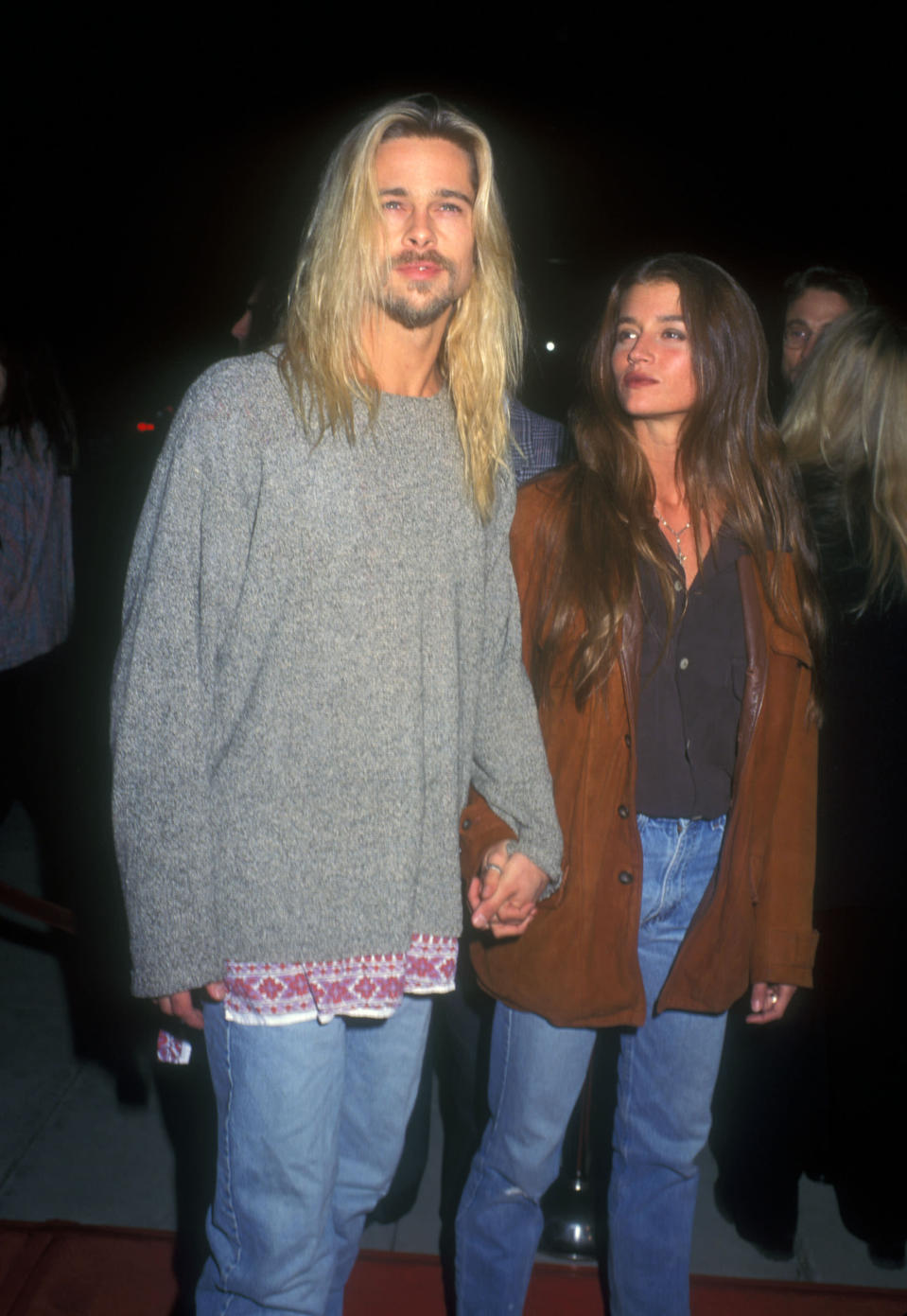 <p>In 1994, Brad channeled his inner hippie when he stepped out with then girlfriend Jitka Pohledek, who wore her flowing locks in a boho down style. Photo: Getty Images </p>