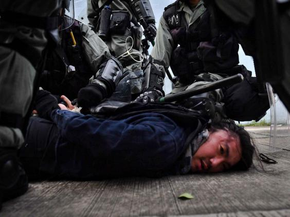 Riot police detain a protester at Kowloon Bay in Hong Kong (AFP/Getty)