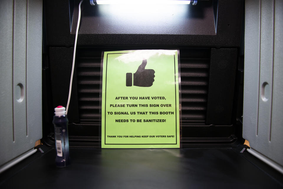 BEMIDJI, MN - SEPTEMBER 18: Signage about COVID-19 procedures sits in a ballot booth at the Beltrami County Administration building on September 18, 2020 in Bemidji, Minnesota. Early voting starts today in Minnesota as President Donald Trump and Democratic presidential nominee and former Vice President Joe Biden are both campaigning in the state. (Photo by Stephen Maturen/Getty Images)